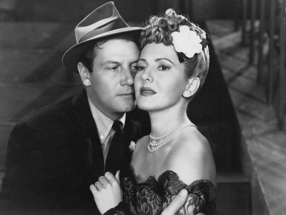 Joel McCrea and Jean Arthur in a scene from THE MORE THE MERRIER, 1943.